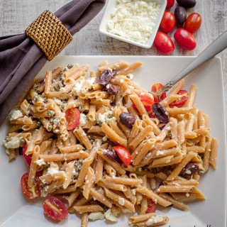 Pasta with feta, olives, garlic, tomato, and capers